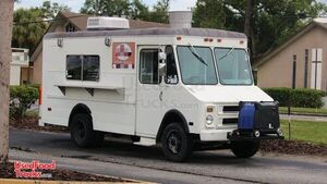 Ready to Serve 19.8' Chevrolet P30 Permitted Mobile Kitchen Food Truck.