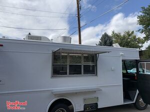 Fully Loaded 26' Chevrolet P30 Self-Contained Mobile Kitchen Food Truck.