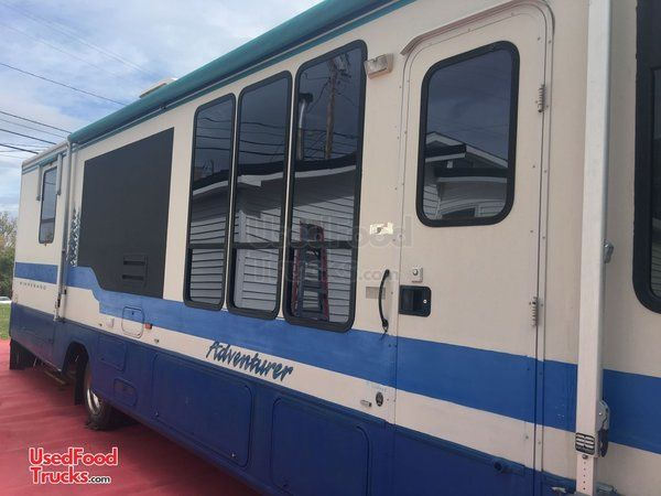 Used 35' Winnebago Adventurer Kitchen Food Truck with Full Bathroom.